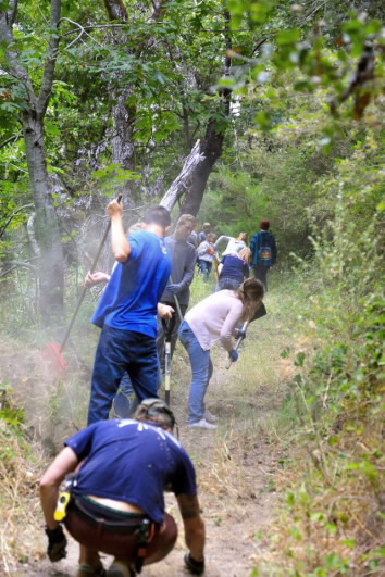 The other service project the senior high helped with at Happy Valley was cleaning the trails. Many of the trails were covered from overgrowth. The camp helped shovel, weed, and rake the trail clean.