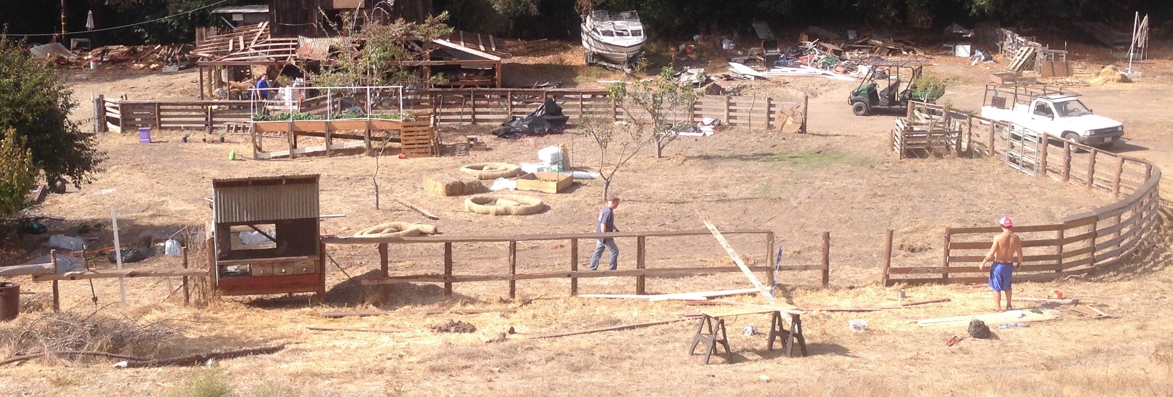 View from the overlooking hill of the corral. The fence is sparce and unfinished.