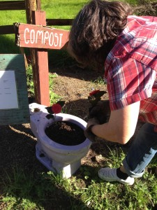 Joni puts the finishing touch on her Lavender Toilet Compost Project!